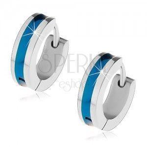 Stalowe kolczyki srebrnego koloru z niebieskim pasem pośrodku obraz