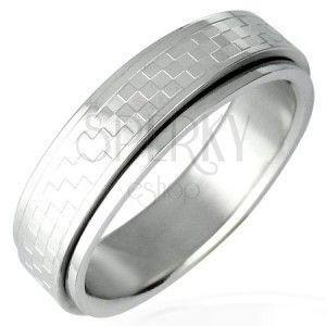 Stalowy pierścionek z obrotowym środkiem - szachownica obraz