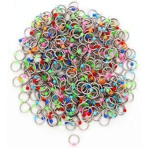 Piercing ze stali z kolorowymi kuleczkami obraz