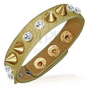 Skórzana bransoletka - złoty pasek z przezroczystymi kamyczkami i złotymi szpicami obraz