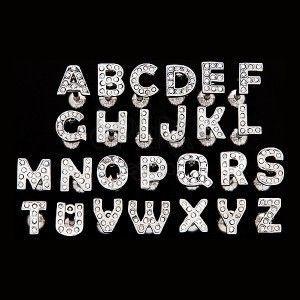 Piercing do języka ze stali - litera z cyrkoniami obraz