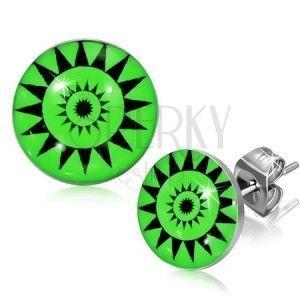 Okrągłe wkręty ze stali - symbol słońca, zielone tło obraz