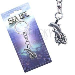 Lśniąca zawieszka na klucze, dwa delfiny wyskakujące z fal obraz