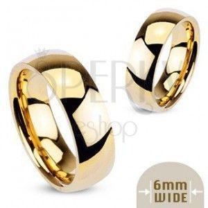 Złoty metalowy pierścionek - gładka lśniąca obrączka obraz