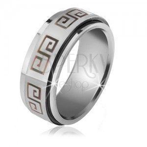 Lśniący pieścień ze stali - matowa obrotowa obręcz, grecki klucz obraz