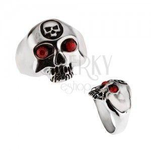 Stalowy pierścionek - czaszka z mniejszą czaszką na czole obraz