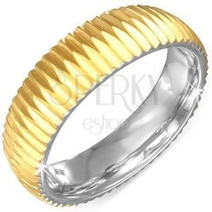 Złocisty karbowany stalowy pierścionek obraz