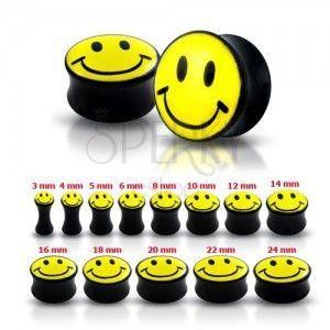 Plug do ucha w kolorze czarnym z żółtym uśmiechem obraz