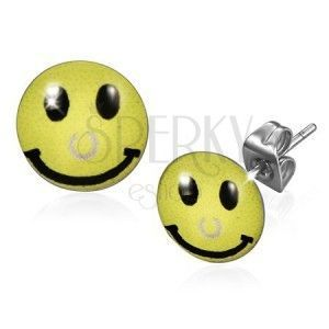 Kolczyki ze stali chirurgicznej, żółty uśmieszek z piercingiem obraz