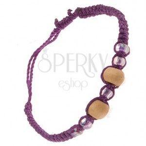 Fioletowa plecionka ze sznurków, drewniane beżowe kuleczki, koraliki obraz