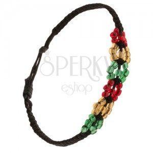 Koralikowe kolorowe kwiatuszki, czarny pleciony sznurek obraz