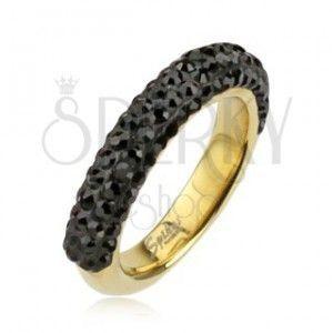 Stalowy pierścionek w złotym kolorze ozdobiony czarnymi cyrkoniami obraz