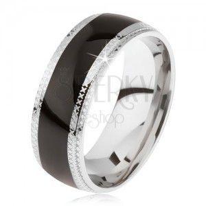 Stalowy pierścionek, lśniący czarny środkowy pas, krawędzie z rowkami obraz