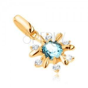 Złoty wisiorek 375 - kwiatek ozdobiony przezroczystymi kamyczkami i niebieskim topazem obraz