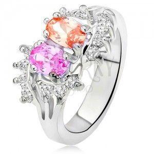 Lśniący pierścionek srebrnego koloru, dwa kolorowe kamyczki, małe przezroczyste cyrkonie obraz