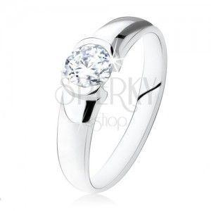 Srebrny pierścionek 925, okrągły przezroczysty kamyczek, lśniąca powierzchnia obraz