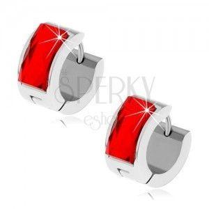 Stalowe kolczyki srebrnego koloru, rubinowo czerwony szlifowany kamyczek obraz