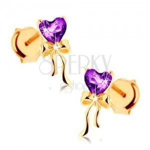 Kolczyki z żółtego złota 9K, fioletowe serduszko z ametystu, lśniąca kokardka obraz