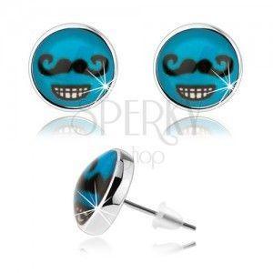 Kolczyki w stylu cabochon, szkło, niebieskie tło, czarne wąsy, zębaty uśmiech obraz