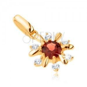 Złoty wisiorek 585 - kwiatek ozdobiony przezroczystymi kamyczkami i czerwonym granatem obraz