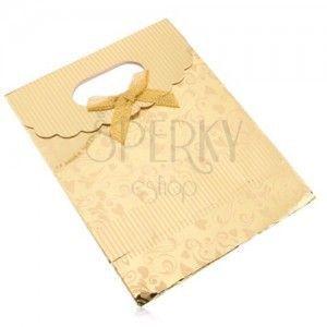 Upominkowa torebka z papieru, lśniąca powierzchnia złotego koloru, serduszka, spirale, paseczki obraz