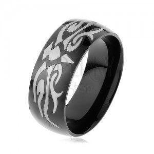 Lśniący stalowy pierścionek czarnego koloru, szary motyw tribala, gładka powierzchnia obraz