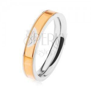 Stalowy pierścionek srebrnego koloru, lśniący pas w złotym odcieniu, węzeł celtycki obraz