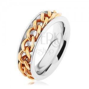 Stalowy pierścionek, łańcuszek złotego koloru, lustrzany połysk obraz