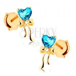 Złote kolczyki 585 - lśniąca kokardka, niebieskie topazowe serduszko obraz