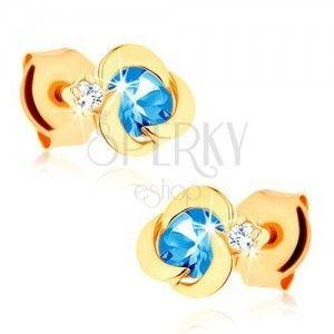 Złote kolczyki 585 - kwiatek o okrągłych płatkach, niebieski topazowy środek obraz