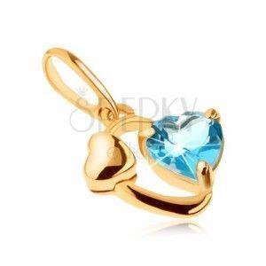 Złoty wisiorek 585 - zarys owalu, lśniące serduszko, serce z niebieskiego topazu obraz