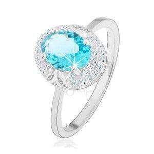 Rodowany pierścionek, srebro 925, jasnoniebieski cyrkoniowy owal, wycięcia obraz