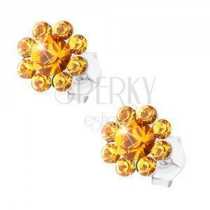 Kolczyki ze srebra 925, błyszczący kwiatek z pomarańczowych kryształków Preciosa obraz
