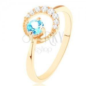 Złoty pierścionek 585 - sierp księżyca ozdobiony przejrzystymi cyrkoniami, niebieski topaz obraz