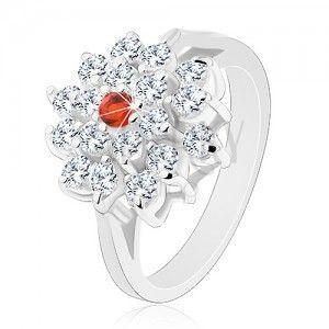 Pierścionek srebrnego koloru, duży przezroczysty kwiat z pomarańczową cyrkonią w środku obraz