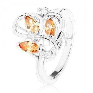 Błyszczący pierścionek srebrnego koloru, faliste pasy, pomarańczowe cyrkonie obraz