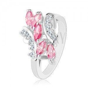 Lśniący pierścionek srebrnego koloru, różowe cyrkoniowe ziarenka, przezroczyste cyrkonie obraz