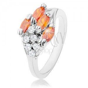 Pierścionek srebrnego odcieniu, pomarańczowe cyrkoniowe ziarenka, przezroczyste cyrkonie obraz