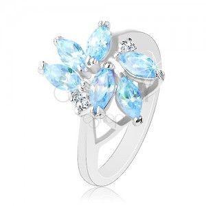 Błyszczący pierścionek o lśniących ramionach, jasnoniebieskie wyszlifowane cyrkonie obraz