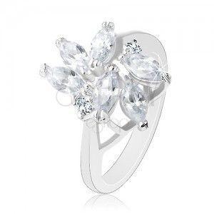 Błyszczący pierścionek srebrnego koloru, przezroczyste wyszlifowane ziarenka, okrągłe cyrkonie obraz