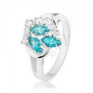 Błyszczący pierścionek z rozdwojonymi ramionami, jasnoniebieskie ziarenka, przezroczyste cyrkonie obraz