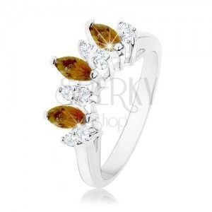 Błyszczący pierścionek srebrnego koloru, przezroczyste i brązowe cyrkoniowe ziarenka obraz