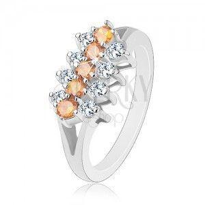 Błyszczący pierścionek ozdobiony cyrkoniowymi pasami bezbarwnego i pomarańczowego koloru obraz