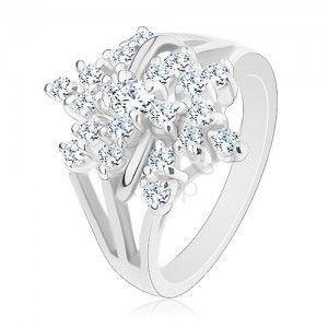 Błyszczący pierścionek, srebrny kolor, przezroczysty cyrkoniowy kwiat, rozgałęzione ramiona obraz