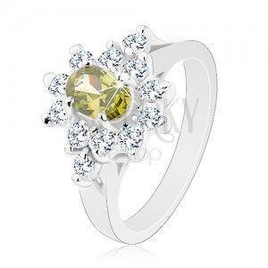 Błyszczący pierścionek, owalna cyrkonia zielonego koloru z przezroczystym zarysem obraz