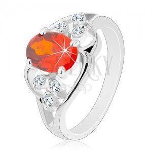 Pierścionek w srebrnym odcieniu, pomarańczowa owalna cyrkonia, faliste linie obraz