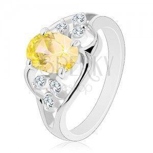 Błyszczący pierścionek w srebrnym odcieniu, owalna cyrkonia żółtego koloru obraz