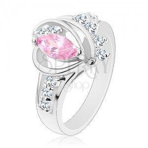 Pierścionek z rozdzielonymi cyrkoniowymi ramionami, duże różowe ziarenko, łuki obraz