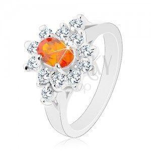 Pierścionek srebrnego koloru, pomarańczowy cyrkoniowy owal z obwódką bezbarwnego koloru obraz