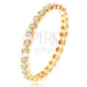 Złoty pierścionek 585 - okrągłe przezroczyste cyrkonie dookoła, faliste krawędzie obraz